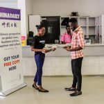 The Newz Point team takes part in distribution marketing for one of its partners, China Daily at Game Stores in Kampala.