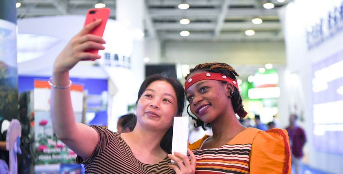 A Ugandan and Chinese lady share a moment at the first China-Uganda Expo (China-Uganda Industrial Capacity Cooperation Exposition) which took place this July from 23rd to 26th at UMA show grounds in Kampala.